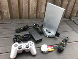 PlayStation 2 console and light up stand. Ps2