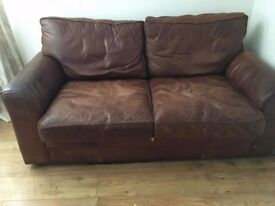 2 old leather 2 seater sofas