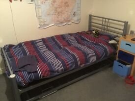 Metal frame single bed with sleepover bed
