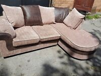 Superb brown and beige corner sofa.Modern design with chase lounge.1 month old. Clean.Can deliver