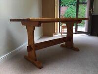 A double pedestal farmhouse style pine kitchen table