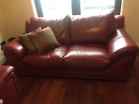 2 lovely red leather Harvey's sofas.