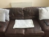 Two and three seater sofa brown leather