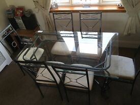 Glass dining room table plus 6 chairs