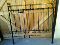 Brass and wrought iron bedstead.