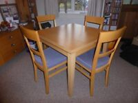 Habitat dining table and four chairs with cushioned seats for sale £150