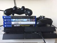 PS4 with 4 games, 2 controllers and USB charging