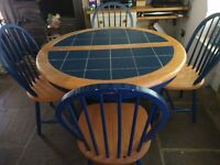 Extendable dining table and 4 chairs with blue tile top