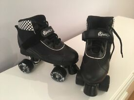 Size 5 roller skates . Worn a couple of times . Collection from wesr Chiltington