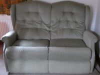 Two seater sofa together with 2 reclining armchairs. Pale green