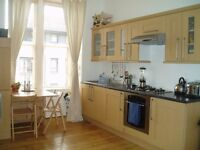 Bright, secure, fully furnished west end flat with double bedroom, wooden floors and garden