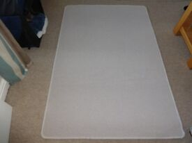 Rug - cream, in a good clean condition. Measures approx. length 58 inches x width 39 inches