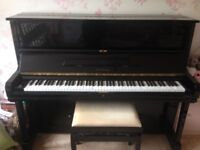 Elysian black upright piano. Made in London.