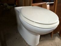 White porcelain toilet pan with seat