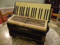 beautiful quality hohner light weight accordian with shoulder straps,in excellent condition.
