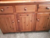 Solid pine sideboard unit with 3 draws and 4 cupboard doors