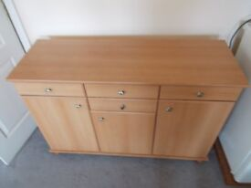 BEECHWOOD SIDE BOARD - VG CONDITION. 4 DRAWERS, 3 CUPBOARDS