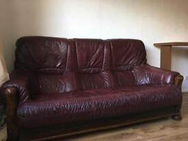 Three wood and leather sofas