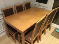 Solid wooden table and six chairs for sale.