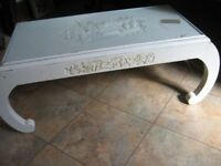 Chinese-style, glass-top coffee table with pattern; ideal up-cycling project.