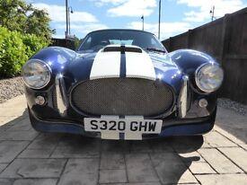 Cobra kit car.