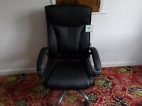 brand new swivel black chair