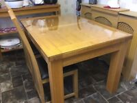 Stockholm extending dining table and four chairs from Gillies of Dundee
