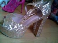 Sequined gold high heels