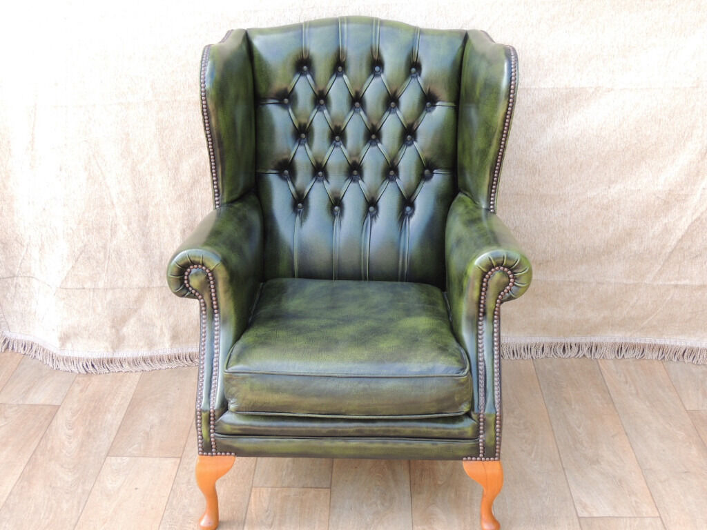 Chesterfield Leather Antique green wing chair (Deliveryin Lewisham, LondonGumtree - Queen Anne Chesterfield (Size 82cm W; 80cm D; 105cm H; Seat Height 46cm; Cushion thickness 11cm); Genuine leather with deep pushed in buttons to the back; Privacy wing sides; Gently rounded armrests; Vintage studs; Queen Anne legs; Beautiful antique...