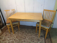 Compact Dining table with 2 chairs could fit 4 people