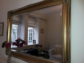 Lovely gilt and bevelled over mantle mirror