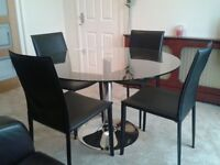 Glass/Chrome Table with 4Black Leather chairs