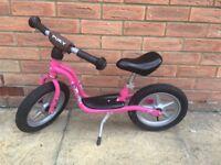 Children's pink balance bike