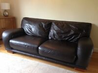 Brown leather sofa and two arm chairs