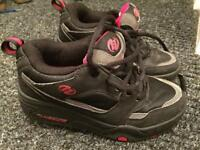 Black and red heelys size 13