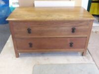 Oak veneered low chest of drawers