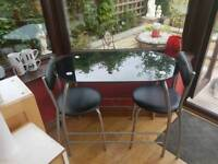 Black table with 2 chairs
