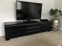 Black gloss TV cabinet with shelves and large draws