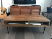 Reclaimed wood industrial style coffee table with steel hairpin legs
