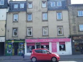 city centre one bed unfurnished flat, second floor, double glazing, electric storage heating