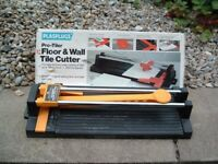 PLASPLUGS FLOOR AND WALL TILE CUTTER.