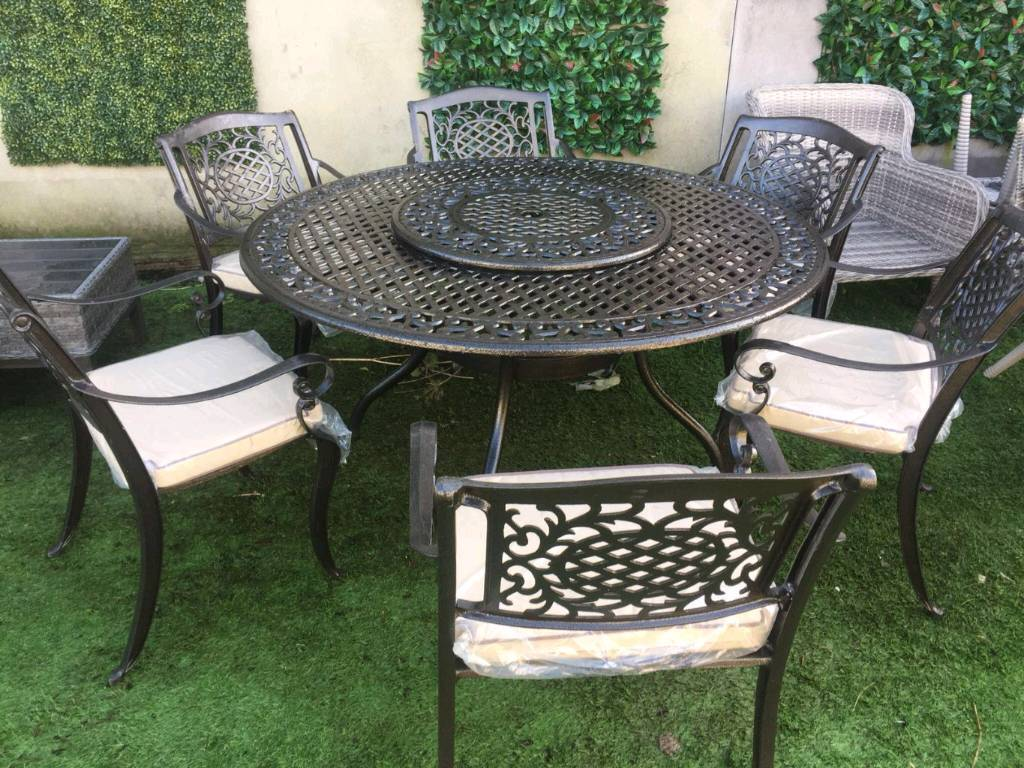 Garden furniture cast aluminium table and chairs