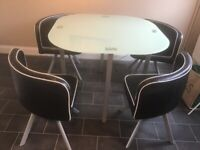 Kitchen glass table and 4 chairs that fit snug under table