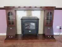 Wooden fire surround and electric fire.