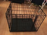 Double door pet cage for small to medium sized dogs