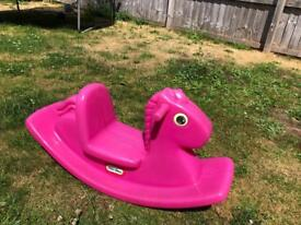 Pink outdoor rocking horse
