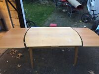 Sturdy dining table with extra panels - can seat 10 when extended.