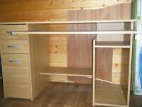 Desk with drawers, cupboard, bookshelf, storage section and slide for keyboard
