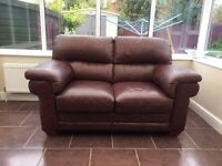 Quality pair of ITALIAN LEATHER two seater SOFAS - matching footstool included