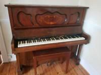 Beautiful Upright Piano and stool.